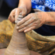 Potter hands making in clay on pottery wheel. — Stock Photo