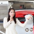 Woman standing in front of a light aircraft — Stockfoto