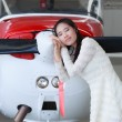 Woman standing in front of a light aircraft — 图库照片