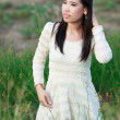 Beautiful Asian woman enjoy nature meadow. — Stock Photo