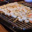 Cooking scallops on the grill — Stock Photo