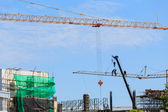 Construction site with cranes on sky background — Stock fotografie