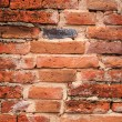 Weathered stained old brick wall background — Foto Stock