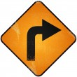 Turn right road sign. Damaged yellow metallic road sign with Tur — Stock Photo