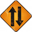 Stock Photo: Two way traffic sign. Damaged yellow metallic road sign with Two
