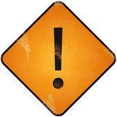 Exclamation Mark Sign on damaged yellow metallic. — Stock Photo