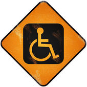 Disabled sign on damaged yellow metallic. — Stock fotografie