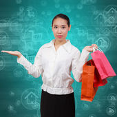Shopping women show empty hands and hold shopping bags.On backgr — Stock Photo