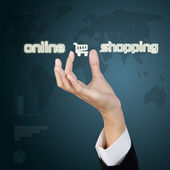 Hand showing virtual symbol of online shopping. — Stock Photo