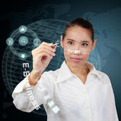 Business woman writing business target on virtual screen. — Foto Stock