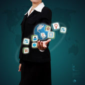 Application icons in human hand. Concept of E-business. — Stock Photo