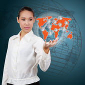 Business woman showing a world map on virtual screen. Concept of — Stock Photo