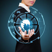 Business woman showing globe and icon application on virtual scr — Stock Photo