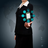 Business woman showing smart phone and icon application on virtu — ストック写真