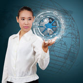 Business woman  showing the globe and icon application on virtua — ストック写真