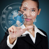 Business woman touching the globe and icon application on virtua — Stock Photo