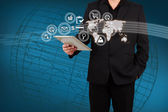 Businessman showing map and icon application on virtual screen. — Stock Photo