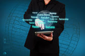 Businessman holding a tablet with virtual globe and business pla — Stock Photo