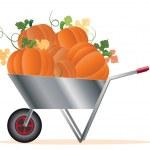 Wheelbarrow with pumpkins — Stock Vector #13969581