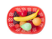 Basket with toy fruits — Stock Photo