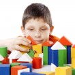 Boy playing toy blocks — Stock Photo