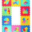 Multicolored frame of foam puzzle — Stock Photo