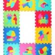 Multicolored frame of foam puzzle — Stock Photo