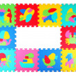 Multicolored frame of foam puzzle — Stock Photo #44179935
