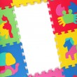 Multicolored frame of foam puzzle — Stock Photo #44179971