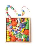 Caixa de madeira com muitos brinquedos — Foto Stock