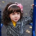Little girl in autumn park — Stock Photo #14045762