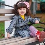 Little girl in autumn park — Stock Photo #14045777