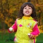 Little girl in autumn park — Stock Photo #14045809