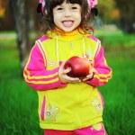 Little girl in autumn park — Stock Photo #14128612