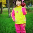 Little girl in autumn park — Stock Photo