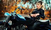 Stylized photo of young beautiful woman and bike — Stock Photo