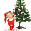 Little girl and christmas tree — Stock Photo