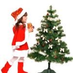 Little girl and christmas tree — Stock Photo #36477471