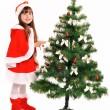 Little girl and christmas tree — Stock Photo