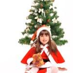 Little girl and christmas tree — Stock Photo #36477479