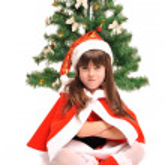 Little girl and christmas tree — Stock Photo #36477495