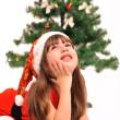 Little girl and christmas tree — Stock Photo #36477501