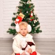 Little girl decorate a christmas tree — Stock Photo