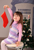 Little girl and christmas tree — Foto de Stock