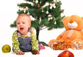 Little girl and christmas tree — Stok fotoğraf