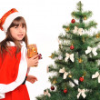 Little girl with a christmas gift — Stock Photo