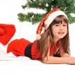 Little girl and christmas tree — Stock Photo #36533739