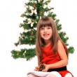 Little girl and christmas tree — Stock Photo #36533757