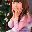 Little girl and christmas tree — Stock Photo #36533763