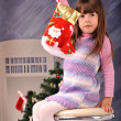 Little girl with a gift — Stock Photo